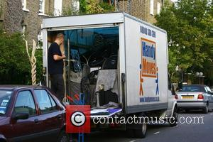 Removal men start loading up possessions belonging to Girls Aloud singer Sarah Harding and her DJ boyfriend Tom Crane as...