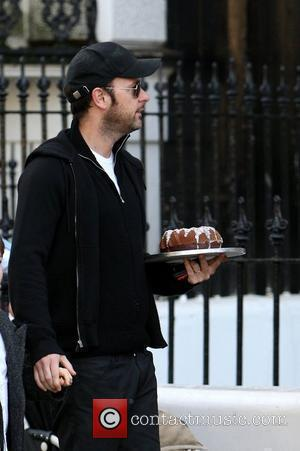 Matthew Vaughn carrying a cake as he takes his son to school London, England - 12.11.09