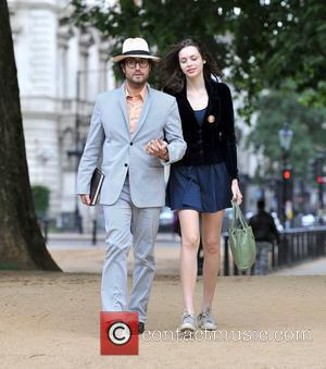 Sean Lennon and girlfriend Charlotte Kemp Muhl dressed for summer as they take a stroll in the park London, England...