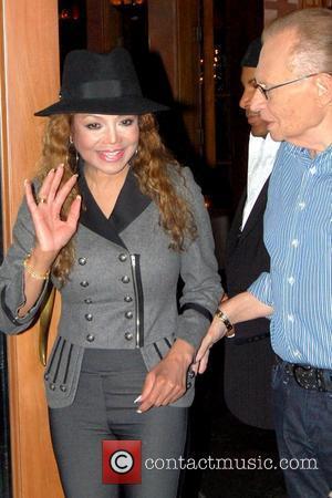 La Toya Jackson and Larry King