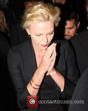 Theron Hospitalised After Health Scare?
