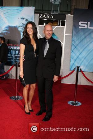 Emma Heming, Bruce Willis The Surrogates premiere held at the El Capitan Theater Los Angeles, California - 24.09.09