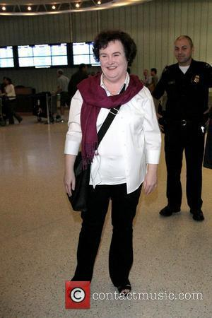 Susan Boyle  arrives at LAX airport on a British Airways flight from Heathrow and is mobbed by photographers, reporters...