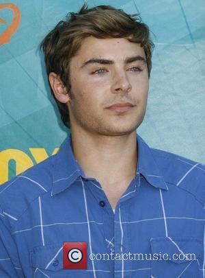 Efron And Hudgens' Engagement Reports 'Not True'