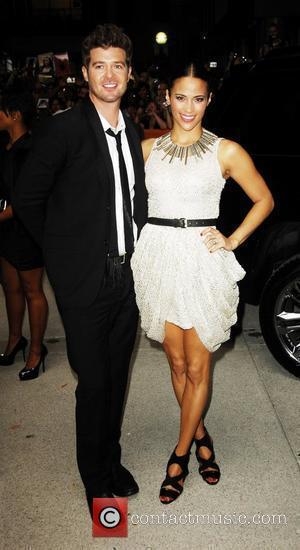 Robin Thicke and Paula Patton