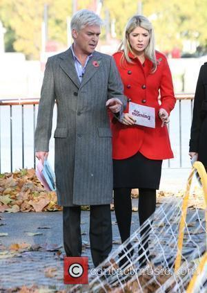 Holly Willoughby and Philip Schofield outside presenting a segment of ITV's 'This Morning' London, England - 04.11.09