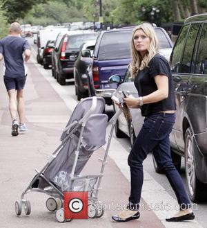 'Holby City' star Tina Hobley takes her daughters to Regents Park London, England - 20.07.09