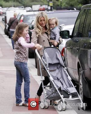 'Holby City' star Tina Hobley takes her daughters Isabella and Olivia to Regents Park London, England - 20.07.09