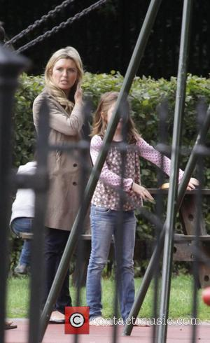 'Holby City' star Tina Hobley takes her daughter Isabella to Regents Park London, England - 20.07.09