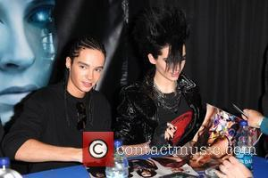 Bill Kaulitz and Tom Kaulitz Tokio Hotel sign copies of their new CD 'Humanoid' at Best Buy New York City,...