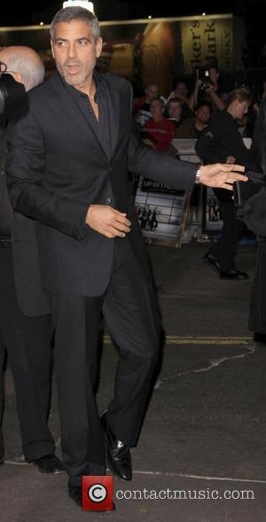 George Clooney arrive at the LA premiere of 'Up In The Air' at the Mann Village Theatre Westwood, California -...