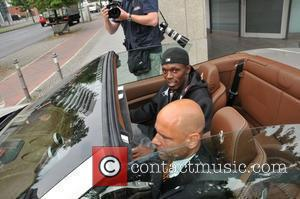 Usain Bolt checks out a Ferrari and is taken for a test drive, at his Hotel. Berlin, Germany - 24.08.09