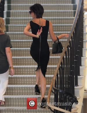 Victoria Beckham, Wearing A Black Zib Back Dress and Walks Up The Stairs Of Barneys New York In Beverly Hills Where She Spent An Hour Of Shopping