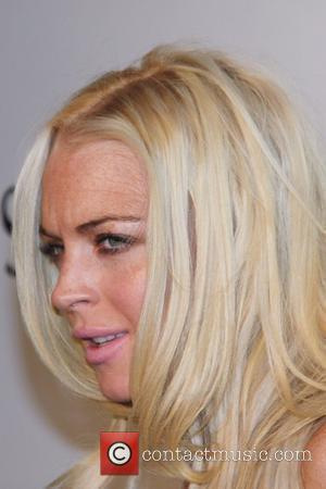 Lohan Still With Record Label