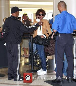 Whitney Houston arriving at LAX airport Los Angeles, California - 03.07.09