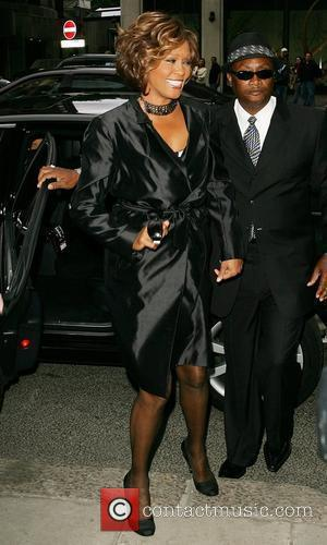 Whitney Houston arrives at a London hotel - she is set to make a comeback with the release of her...