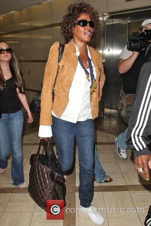 Whitney Houston arriving at LAX airport to catch a Delta flight Los Angeles, California - 03.07.09