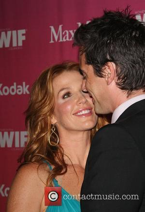 Poppy Montgomery and her husband, actor Adam Kaufman The Women in Film Crystal and Lucy Awards 2009 at the Century...