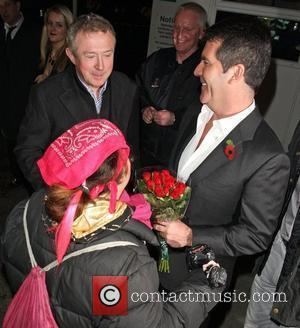 'Celebrity Hugger' Tania McIntosh ignores her favourite 'X Factor' judge Louis Walsh to give Simon Cowell some flowers and a...