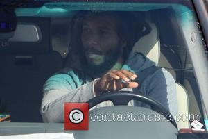 Ziggy Marley  seen in West Hollywood talking on his phone as he picks up his daughter in the car....