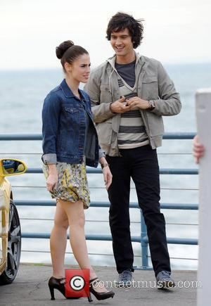 Jessica Lowndes and Michael Steger filming a scene for the TV show '90210' at the Santa Monica Pier. Jessica appears...