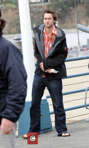 Ryan Eggold rehearsing a scene for the TV show '90210' at the Santa Monica Pier Santa Monica, California - 25.01.10