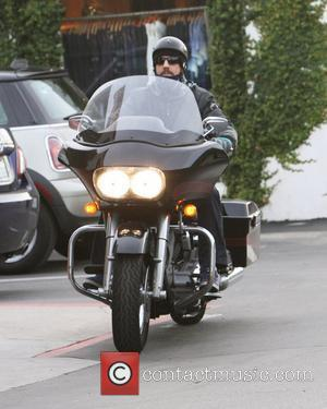 Anthony Kiedis of the Red Hot Chili Peppers takes his Harley Davidson Motorcycle for a ride in Cross Creek Malibu,...