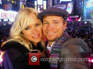 Brian Littrell of the Backstreet Boys and his wife Leighanne Wallace posted a photo of themselves before the Times Square...