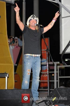 Bret Michaels performing live on stage prior to the Miami Dolphins vs New England Patriots NFL game at Sun Life...