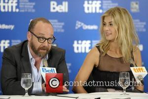Paul Giamatti and Rosamund Pike