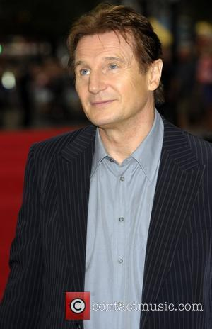 Neeson Goes Public With New Love