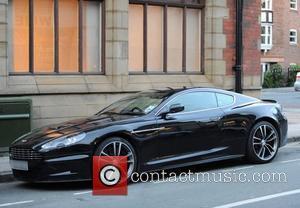 Adam Johnson's Aston Martin DBS car Adam Johnson with a female companion, the Manchester City football player, arriving at Alderley...
