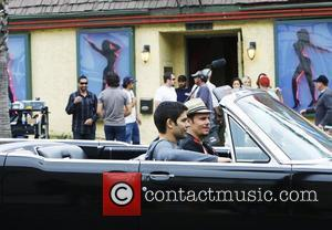 Adrian Grenier and Kevin Dillon filming a scene for 'Entourage' in a Lincoln convertible car Los Angeles, California - 15.04.10