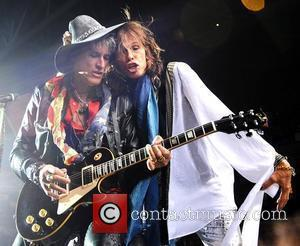 Joe Perry and Steven Tyler Aerosmith performing live in concert at O2 Arena London, England - 15.06.10