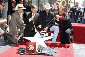 Alan Jackson and Shawn Parr  Alan Jackson is honoured with the 2405th star on the Hollywood Walk of Fame...