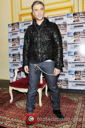 Mexican singer Alejandro Fernandez attends a photocall for his new album 'Dos Mundos' at the Palace Hotel Madrid, Spain -...