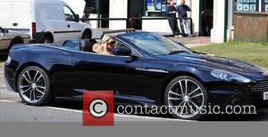 Alex Curran The wife of England captain Steven Gerrard driving in her Aston Martin DBS Convertible on a sunny day...