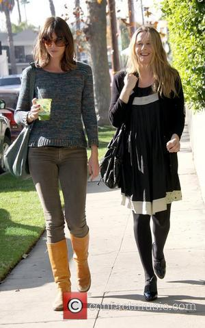 Alicia Silverstone leaving the vegetarian restaurant Real Food Daily in West Hollywood after having lunch with a friend Los Angeles,...