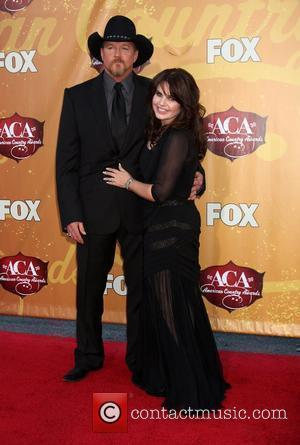 Trace Adkins and Guest The 2010 American Country Awards at MGM Grand Garden Arena - Arrivals Las Vegas, Nevada -...
