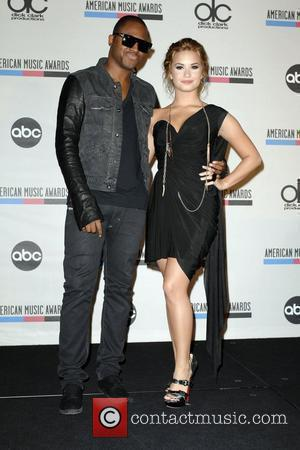Taio Cruz and Demi Lovato