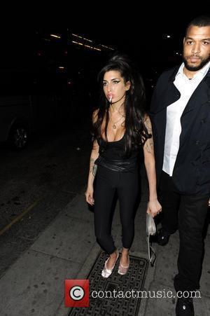 Amy Winehouse smokes a cigarette outside a pub in Camden London, England - 02.07.10