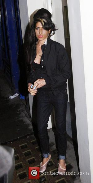 Amy Winehouse leaving a bar in Great Compton Street, Soho with friends in the early hours of this morning. The...