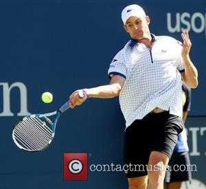 Andy Roddick of the United States competes against Stephane Robert of France during the Men's Singles Tournament on Day One...