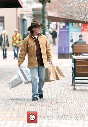 Kurt Russell shopping in Aspen wearing a Stetson hat. Aspen, Colorado - 22.12.10