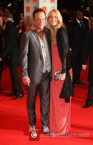 Mickey Rourke and guest The Orange British Academy Film Awards (BAFTA Awards) held at the Royal Opera House - Arrivals...