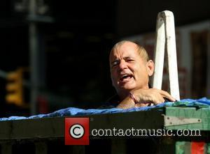 Bill Murray wet after diving into a makeshit pool while filming a segment outside The Ed Sullivan Theater for the...