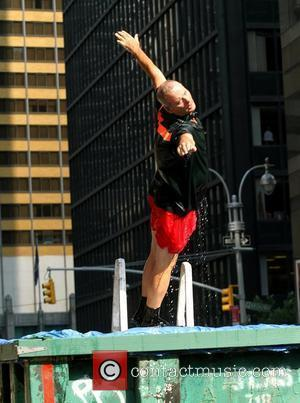 Bill Murray diving into a makeshift pool  while filming a segment outside The Ed Sullivan Theater for the 'Late...