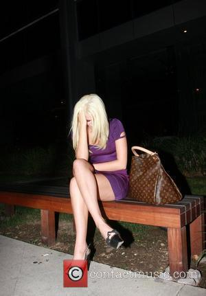 Karissa Shannon sits outside Boa restaurant after having dinner with her boyfriend. The couple is said to be taking legal...