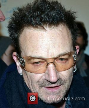 Bono  busking with musicians on Grafton Street on Christmas Eve for charity. Dublin, Ireland - 24.12.10.