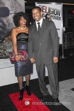 Actor Denzel Washington & Paulette Washington Los Angeles Premiere of 'The Book Of Eli' held at the Grauman's Chinese Theater...